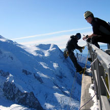 Scientist rappeling down the Aiguille du Midi